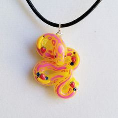 Tropical Smoothie Snake Pendant. Complete with miniature fruit. Crafted from polymer clay by The Clay Kiosk on Etsy.
