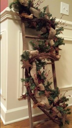 4 ft primitive ladder with pine garland, burlap ribbon, red pip berry, rusty stars and burlap feathered birds... by Kim Houston, 2 Ladies in the Attic