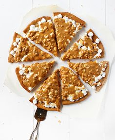 Seriously delicious dessert pizza. This flavor combination seems unassuming, but will absolutely knock your socks off! Peanut butter, marshmallow, butterscotch. Ah-mazing.