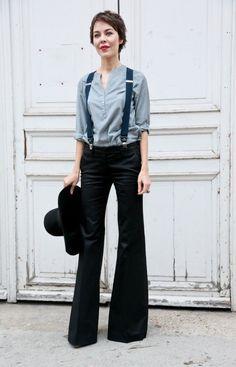 Grey top, black wide leg pants, suspenders.