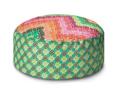 This beautiful pouf sports a crochet zigzag pattern that's dotted with green, pink, orange and peach flowers. Talk about a holiday bouquet. Onley Outdoor PW Pallina Pouf by Missoni Home;  yliving.com
