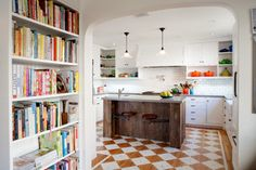Painted wood floor, mix of cabinet types, good vent hood