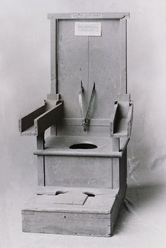 Chair formally used to treat violent patients.   An original glass negative taken from a New York state asylum in the early 20th Century.