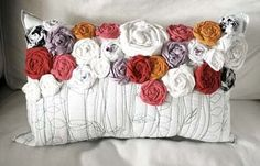 Recycled Roses Pillow {{dreamy sigh}} by Alisa Burke. She has a great tutorial and since I absolutely *LOVE* making these little flowers, this one is next on my hit list...