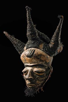 """Africa   Mask """"phumbu"""" from the Pende people of DR Congo   Wood, paint, raffia and natural fiber   When the """"phumbu"""" mask appeared, it was frequently accompanied by an assistant wearing a """"tundu"""" mask. His task was to find a good seat for the chief with the best possible view."""