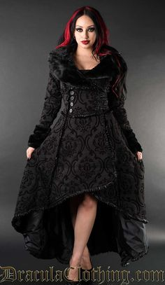 A rich, black and black cotton jacquard that we custom made. It is made in two layers, the first layer has a slightly velvety look, the red is woven over the black base material to create a super thick heavy brocade fabric with red details.<br /> <br /> The coat weighs more than two kilos in most sizes.<br /> <br /> The coat is 143cm long or around 56 inches from the neck and to the longest point in the back.