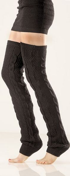 These extra long black open crochet cable leg warmers are SO cozy. The knit leg warmers are 32 inches long and so soft! They are 100% acrylic.They are very thick and soft and stretchy and will fit over most size legs, and stay up very well. They are great under dresses, or over tights...