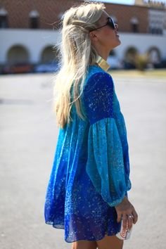 I'm not sure if this is a dress, or a blouse, but gosh it's pretty!! Beautiful with her blonde locks and tanne skin.