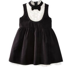 This dress is THE BEST!!  The picture doesn't even do justice to the details..the white part is all rosettes, and there are rhinestone buttons:D    Harajuku Mini for Target® Toddler Girls' Sleeveless Tux Dress - Black