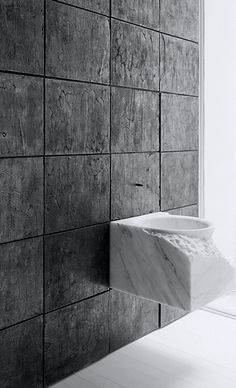 Deconstructed bathroom elegance. Marble vanity | dark textures wall Georgio Rava for Henry Timi | tailored container bronze, 2014