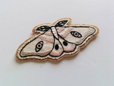 Hand Embroidered Canvas Moth Patch | Canvas & Wool Light Moth by eradura on Etsy https://www.etsy.com/listing/248017455/hand-embroidered-canvas-moth-patch