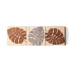 Modular wood-carved wall panels featuring a Monstera leaf motif.