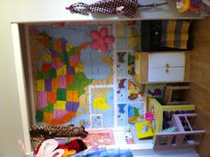 My daughters closet. US Map, DIY play kitchen stove and a $1 sink cupboard we found at a daycare sale. Her small 10x10 room feels bigger with this closet space put to better use.