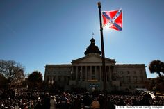 The Confederate Flag Isn't Budging From South Carolina's Capitol -- Because It's Protected Under State Law The morning after nine people were shot to death Wednesday inside a historic black church in Charleston, South Carolina, flowers were laid, black cloth was draped and flags at the state's Capitol building were lowered to half-staff. Except one. The fact that the Confederate flag was waving high in the state capital of Columbia hours after suspected gunman Dylann Roof carried out what's…