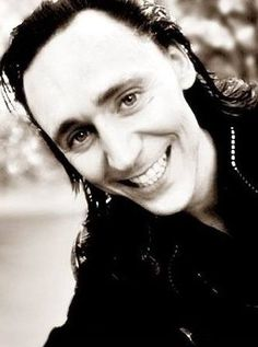 Tom Hiddleston as Loki. That is a Hiddles smile and not a Loki smile.