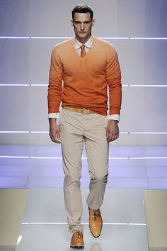 Mens orange sweater and casual pants . Salvatorre Ferragamo Spring Summer