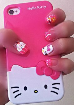 Cute and sweet! Perfect Hello Kitty nails for shorter than usual nails. Don't you just love the bright and colorful shades that play around the different designs on each nail? From a pink and white muffin with multi-colored sprinkles to a floral nail, striped tip nail and finally Hello Kitty herself.