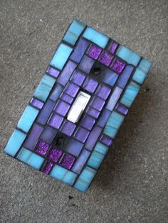 Glass Mosaic Light Switch Plate Cover in Purple and Aqua - Switchplate    Reserved for misty78213  two matching mosaic switch plates as pictured    Are your switchplates still running around nude? Maybe it is time to dress them up! Mosaic light switches add sparkle and color to any room.  I created this mosaic light switch plate cover using a variety of colored glass tiles. I created the border using an aqua/teal blue colored metallic glass accented with purple metallic and glitter glass...