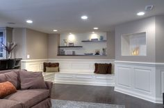 Elegant Finished Basement - a bench over top of the pipe