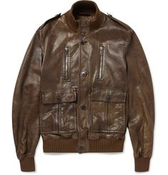Pre-aged for a vintage effect, this brown leather bomber jacket by Gucci will lend a timeless, 70s cool to your look.