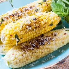 Grilled Garlic Parmesan Corn   Spicy Southern Kitchen   this is fabulously buttery and garlicky and flavored with fresh basil and red pepper flakes. Perfect for a bbq or picnic!