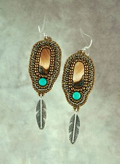 These lightweight and easy to wear earrings are made from a matched pair of picture jasper cabochons and are accented with turquoise beads and a variety seed beads . They measure 1 inch wide by 3 inches in length from the bottom of the sterling silver ear wires to the bottom of the antiqued silver brass feather. These-one-of-a-kind earrings are backed with ultra suede.