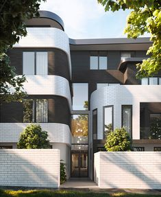 Rounded edges with classic black  white color palette. These architect design residences by C.Kairouz Architects amplify luxury living with a modern spin on traditional architecture. Click link for more  #architecturehouse #architecture #modernhouse #exteriorhousedesign #facade #curves #architecturaldigest #artdeco #style #luxuryhome #classic #traditional #blackandwhiteaesthetic