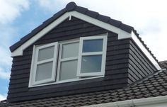 a wide single pitched roof dormer, with triple pane windows