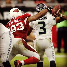 #AZCardinals DE @Penny Calais campbell hunts down #Seahawks QB Russell Wilson in 2012. Thursday Night Football starts at 5:25pm tonight! #SEAvsAZ #nfl #TNF #nflnetwork #azlottery #photooftheday