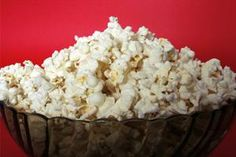 popped popcorn in bowl red background