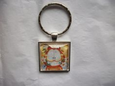 Hey, I found this really awesome Etsy listing at https://www.etsy.com/listing/253367828/garfield-in-flowers-jim-davis-silver