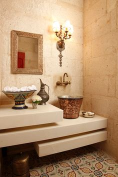 This vessel sink is truly unexpected, the shape and design enhance this powder-loo. Hammam bucket as a sink @ the Hezen Cave Hotel in Turkey.
