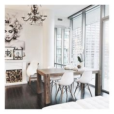 Happy Monday Loves! We just got our dining table yesterday and we are swooning over it. #CasaJohnChristopher...Tap For Sources: Knoll Barcelona Ottoman in white / Herman Miller Eames Eiffel chairs / Structube Hamburg Dining Table / Gluckstein Home Brass and mirrored Tray.
