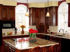 Different (but close) color to the Antique Mascarello; similar color cabinets; I like the tile (and it's stone) as the backsplash. Don't usually like stone. Maybe a good compromise?