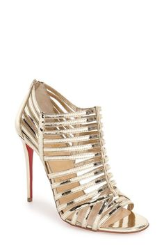 Free shipping and returns on Christian Louboutin 'City Jolly' Cage Sandal at Nordstrom.com. Gleaming metallic leather illuminates the strappy cage silhouette of a scene-stealing open-toe sandal set on a svelte stiletto heel. The vibrant red-lacquer sole finishes the look with iconic Louboutin glamour and rock-and-roll edge.