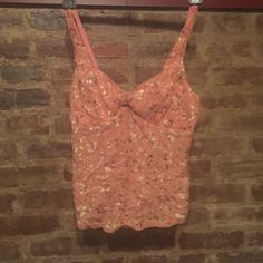 ONE DAY SALE Free People camisole top Dusty pink Free People camisole-style top with a metallic floral print. NWOT. Size small. This color just doesn't look good on me, but it's really cute! Free People Tops Camisoles