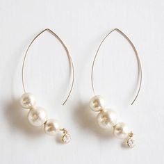 long drop earrings with pearls and little crystal charms as a lovely detail