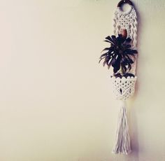 Neato! (can i say that? seems appropriate.) You wouldn't be able to use a very heavy plant in this but it would be worth it to keep a small plant just to have this on my wall. (Pinner said: Loving Justina's Macrame plant hanger! (from Handiwork on Etsy)