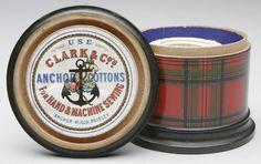 "Stuart tartan ware sewing box advertises Clark thread. Pre 1900, designed to hold one ball of thread (crochet?).  Abt 3-1/4"" in diameter, 2-1/2"" tall."