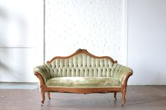 Thurmont - A classic style settee upholstered in sage green, featuring tufted & wood carved details. *Vintage & Eclectic Furniture Rentals for Events, Weddings & Photo Shoots*