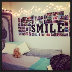 Cute way to furnish your dorm room! A cheap tapestry, homemade painted wooden letters from micheal's, string Christmas lights, and photos :)
