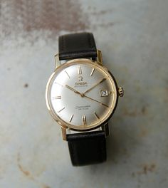 This Seamaster 18ct Gold De Ville is a very rare find. A truly elegant timepiece, built around 1963; having the classic champagne dial with gold hands and baton markers, it measures 35mm in diameter and carries the distinct Seamaster logo on the reverse. The 18ct gold case holds the original 24 jewels calibre 562 automatic movement with its 19,800 bph (5.5 beats per second) providing for a sweeping second hand … Read More →