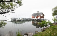 The Bozzuto Boathouse sits on the calm shores of Seneca Lake on a foggy morning. Hobart And William Smith, Seneca Lake, Foggy Morning, Boathouse, Geneva, Acre, Roots, Beautiful Places, Finger