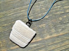 Seashell Jewelry: Broken Seashell Necklace on Blue Leather Cord featuring New…