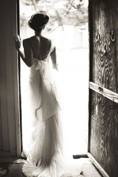 pleated Vera Wang gown and a classic updo; photo by Nancy Neil