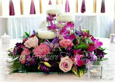 Luscious garden flowers surround floating candles and submerged orchid blooms.