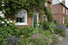 Impressive Cottage Gardens: Small Size, Big Impact: Not all cottage gardens occur on large lots or grand estates. Some of the most charming and well-kept flowering plots happen on very small swaths of land. If you plant a small cottage garden, it's still wise to include one or two large accent plants, shrubs, or trees to keep the garden from looking too precious.