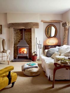 Tall fireplace with wood burning stove and rustic beam mantel