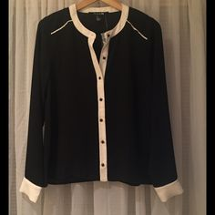 NWT Forever 21 Black Button Up Blouse Forever 21 NWT black button up the front blouse with white trim around neckline, armbands, and placket. Metallic square buttons. Approximately 22.5 inches total length, 18 inches armpit to armpit, 18 inches armpit to end of sleeve. Material 100% polyester Forever 21 Tops Button Down Shirts