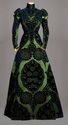 Charles Frederick Worth tea gown dress circa from Paris, France 1895. Iridescent effects rich damask and velvet fabric created by artisans in Lyon, in 18 century, in vogue at the time. The Tea Gown is very personal taste of the designer, as it's bring Neo Renaissance and Oriental in the period of 1899-1900. Green satin silk background patterns and cut midnight blue velvet, lined with green silk taffeta. #Haute #Couture #Hautecouture #Fashion House of Worth.
